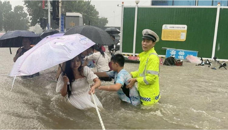 China's Henan province hit by rainy deluge, leaving at least 25 dead